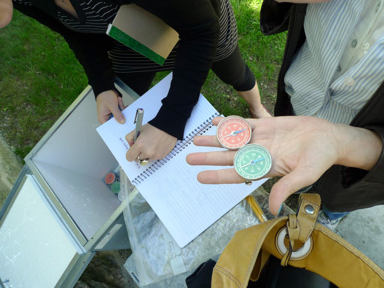 Ruti and Laurie log their visit and claim their compasses